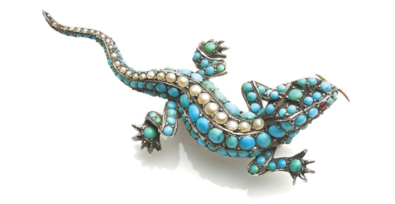 A Victorian silver mounted lizard set with cabochon turquoises and a single line of seed pearls, the eyes ruby set, 60 mm long, c1860, £1,500 from Richard Ogden Ltd
